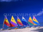 ANTIGUA, West Coast, row of sailboats lined up along beach, ANT648JPL