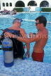 ANTIGUA, instructor giving scuba diving lesson, in pool, ANT805JPL