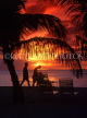 ANTIGUA, sunset with coconut trees and holidaymakers in silhouette, ANT728JPL