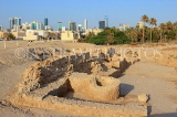 BAHRAIN, Manama, Karababad, Bahrain Fort (Qal'at al Bahrain), excavations, Manama skyline