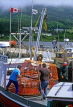 CANADA, Nova Scotia, fishermen with nets, on trawler, CAN687JPL