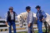 FRANCE, Languedoc-Roussillon, LA CAMARGUE, Cowboys with White Horse, FRA611JPL