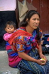 GUATEMALA, Antigua, woman carrying child, GUA403JPL