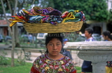 GUATEMALA, Antigua, woman selling purses (basket balancing on head), GUA402JPL