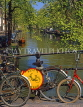 HOLLAND, Amsterdam, canal scene and bicycle on bridge, HOL683JPL