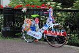 HOLLAND, Edam, decorated bike by a canalside bridge, HOL814JPL