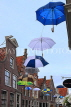 HOLLAND, Edam, old town street decorated with umbrellas, HOL819JPL