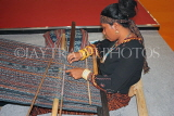 INDONESIA, traditional crafts, Ikat Weaving, weaver with loom at work, INDS1271JPL