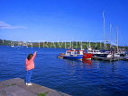 IRELAND, County Cork, KINSALE harbour, boats and girl at pier, IRE218JPL