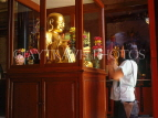 SINGAPORE, Little India, Leon San See temple, smiling Buddha figure, and worshipper, SIN283JPL