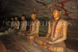 SRI LANKA, Dambulla Cave Temple (Golden Temple), row of seated Buddha statues in cave, SLK2805JPL