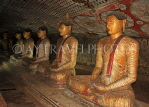 SRI LANKA, Dambulla Cave Temple (Golden Temple), row of seated Buddha statues in cave, SLK2806JPL