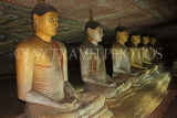 SRI LANKA, Dambulla Cave Temple (Golden Temple), row of seated Buddha statues in cave, SLK2862JPL