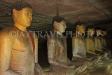 SRI LANKA, Dambulla Cave Temple (Golden Temple), row of seated Buddha statues in cave, SLK2863JPL