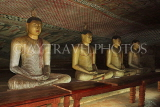 SRI LANKA, Dambulla Cave Temple (Golden Temple), row of seated Buddha statues in cave, SLK2864JPL