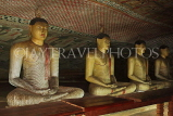 SRI LANKA, Dambulla Cave Temple (Golden Temple), row of seated Buddha statues in cave, SLK2865JPL