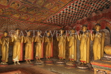 SRI LANKA, Dambulla Cave Temple (Golden Temple), row of standing Buddha statues in cave, SLK2781JPL