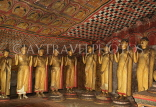 SRI LANKA, Dambulla Cave Temple (Golden Temple), row of standing Buddha statues in cave, SLK2782JPL