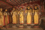 SRI LANKA, Dambulla Cave Temple (Golden Temple), row of standing Buddha statues in cave, SLK2783JPL