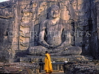SRI LANKA, Polonnaruwa, Gal Viahre (stone temple), granite carved seated Buddha, and monk, SLK100JPL