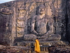 SRI LANKA, Polonnaruwa, Gal Viahre (stone temple), granite carved seated Buddha, and monk, SLK1622JPL