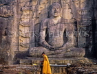 SRI LANKA, Polonnaruwa, Gal Viahre (stone temple), granite carved seated Buddha, and monk, SLK1948JPL