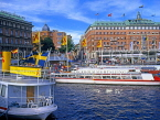 SWEDEN, Stockholm, City view at Stromkajen with pleasure boats and Grand Hotel, SWE112JPL