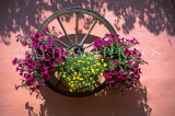 SWITZERLAND, Valais, Alps, Le Tretien, cart wheel with flower box,, on house wall, SW1422JPL