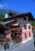 SWITZERLAND, Valais, LE TRETIEN, village street and chalet with flowers, SW1415JPL