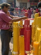 THAILAND, Bangkok, Chinese New Year, lighting candles for good luck at a shrine, THA2099JPL