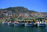 TURKEY, Dalyan Delta, tour boats at site of Lycian Rock Tombs, TUR609JPL