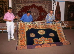 TURKEY, Istanbul, shopping, salesmen displaying hand woven carpets, TUR264JPL