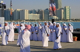 UAE, ABU DHABI, The Corniche, men performing a traditional cultural show, UAE692JPL