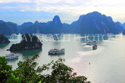 VIETNAM, Halong Bay, Ti Top Island, view towards limestone formations and cruise boats, VT1788JPL