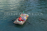 VIETNAM, Halong Bay, boat vendor with snacks for selling to cruise boat tourists, VT1888JPL