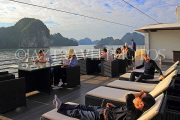 VIETNAM, Halong Bay, cruise boat, tourists relaxing on deck, VT1907JPL