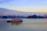 VIETNAM, Halong Bay, dawn, limestone formations and moored cruise boat, VT1820JPL
