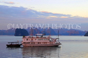 VIETNAM, Halong Bay, dawn, limestone formations and moored cruise boat, VT1821JPL
