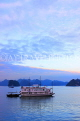 VIETNAM, Halong Bay, dawn, limestone formations and moored cruise boat, VT1822JPL