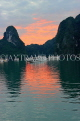 VIETNAM, Halong Bay, dawn, limestone formations and moored cruise boats, VT1808JPL