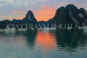 VIETNAM, Halong Bay, dawn, limestone formations and moored cruise boats, VT1809JPL