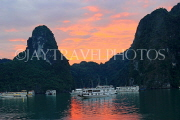 VIETNAM, Halong Bay, dawn, limestone formations and moored cruise boats, VT1810JPL