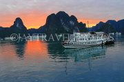 VIETNAM, Halong Bay, dawn, limestone formations and moored cruise boats, VT1811JPL