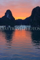 VIETNAM, Halong Bay, dawn, limestone formations and moored cruise boats, VT1812JPL