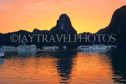 VIETNAM, Halong Bay, dawn, limestone formations and moored cruise boats, VT1815JPL