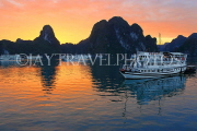 VIETNAM, Halong Bay, dawn, limestone formations and moored cruise boats, VT1816JPL