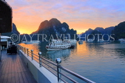 VIETNAM, Halong Bay, dawn, limestone formations and moored cruise boats, VT1824JPL