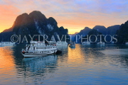 VIETNAM, Halong Bay, dawn, limestone formations and moored cruise boats, VT1825JPL
