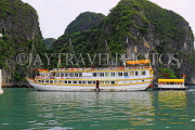 VIETNAM, Halong Bay, moored cruise boat and limestone formations, VT1852JPL