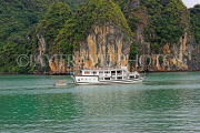 VIETNAM, Halong Bay, moored cruise boat and limestone formations, VT1853JPL